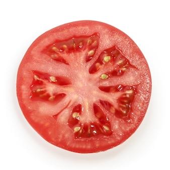 Pomidorowy plasterek odizolowywający na białym tle
