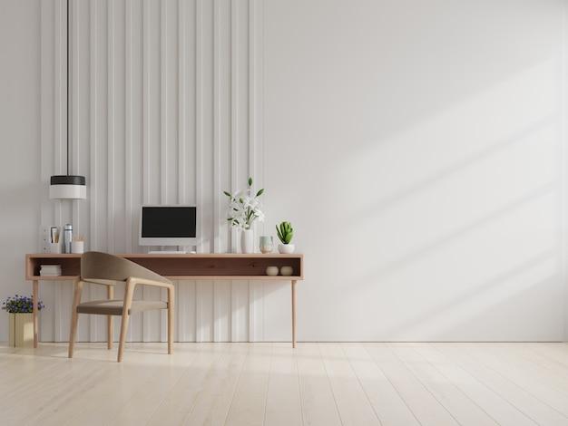 Pomieszczenie biurowe z białą ścianą.
