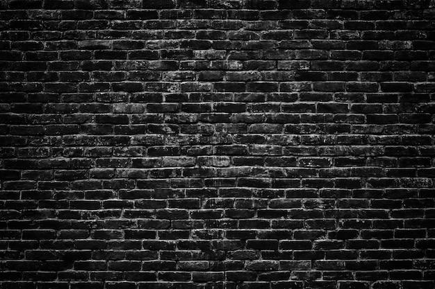 Ponure tło, czarny mur z cegły