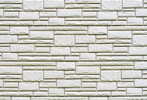 Popielata ściana z cegieł tekstura budynek.