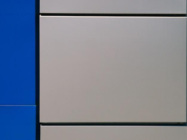 Popielaty błękit ściany metalu panel budynku zbliżenia tła tekstura
