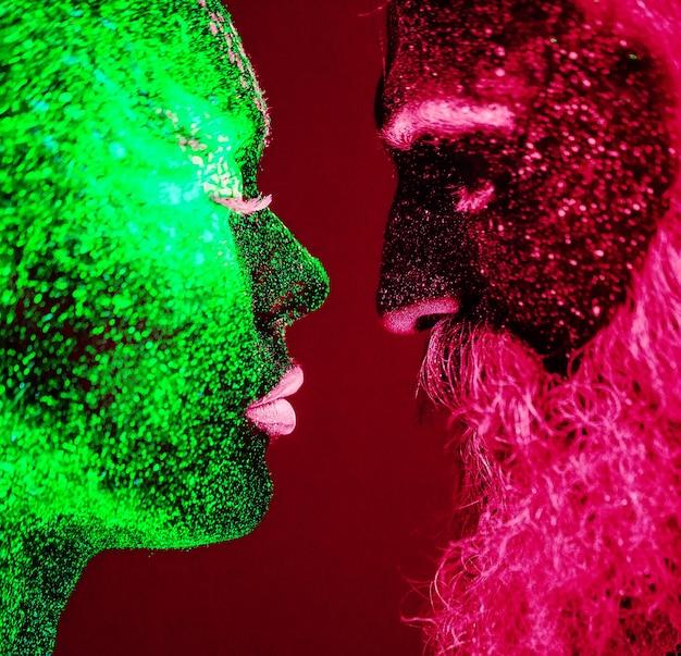 Portret brodatego mężczyzny i kobiety malowany proszkiem ultrafioletowym.