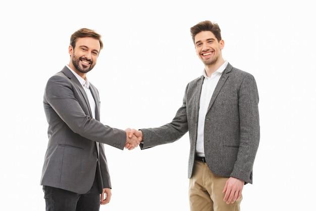 Portret dwóch mężczyzn pewnie biznesu