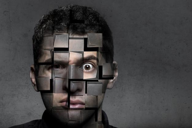 Portret mężczyzny o zdziwionym spojrzeniu, który rozpada się na kostki, pojęcie kłopotów i samozniszczenia