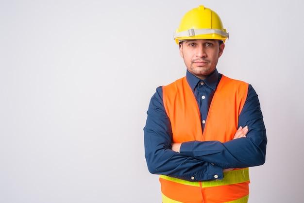 Portret młodego przystojny mężczyzna irański pracownik budowlany na białym tle