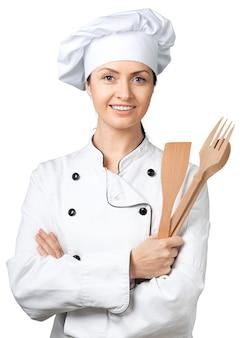 Portret młodej kobiety szefa kuchni na białym tle