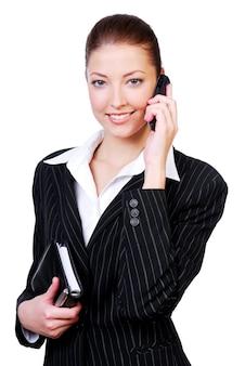 Portret młodej pomyślnej pięknej bizneswoman