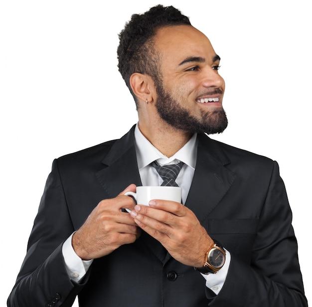 Portret przystojny biznesmen z filiżanką kawy.