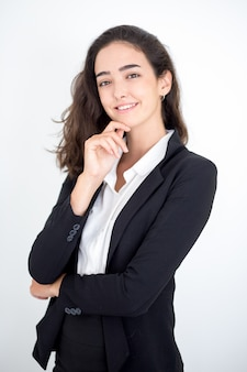 Portret szczęśliwy kierownik żeński dotykając twarzy