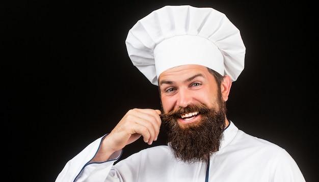 Portret szczęśliwy szef kuchni z kapeluszem cooka
