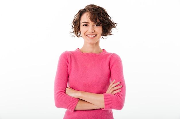 Portret ufna uśmiechnięta dziewczyny pozycja z rękami składać