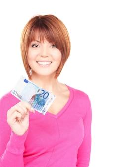 Portret uroczej kobiety z pieniędzmi w gotówce