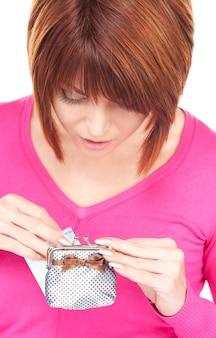 Portret uroczej kobiety z torebką i pieniędzmi
