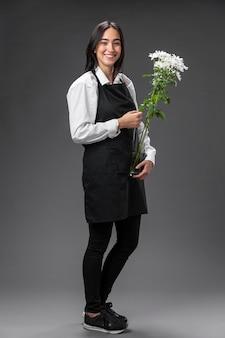Portret żeński kwiaciarnia z kwiatami