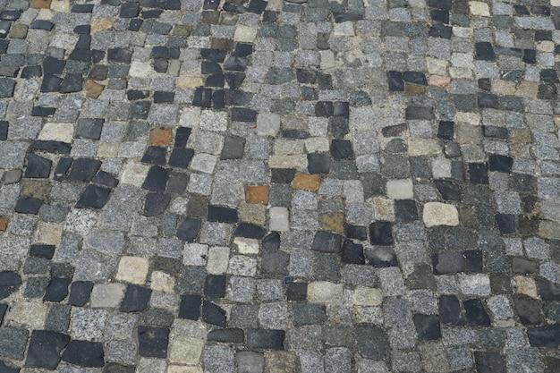 Portugalski kamienny bruk lub calcada portuguesa road