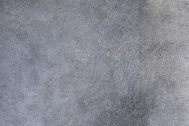 Porysowana metalowa tekstura, tło szczotkowanej blachy stalowej
