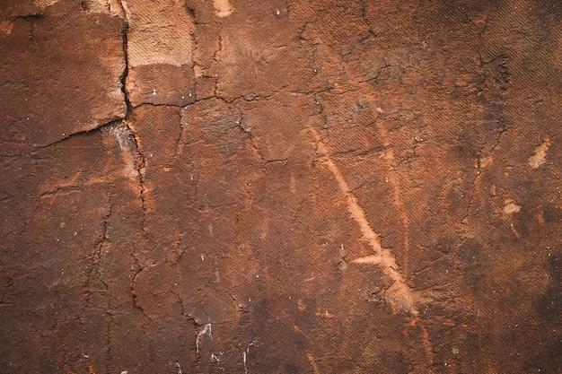 Porysowana sklejka, stare drewniane tekstury, brązowe tło. brudna powierzchnia panelu. vintage pęknięta deska, drewno.