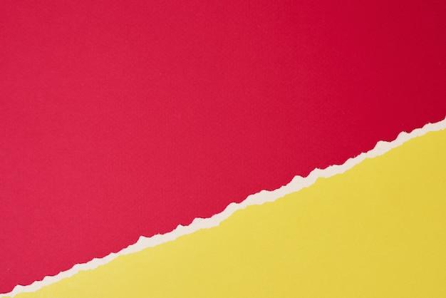 Poszarpana krawędź zgrywanie papieru z miejsca kopiowania, koloru czerwonego i żółtego