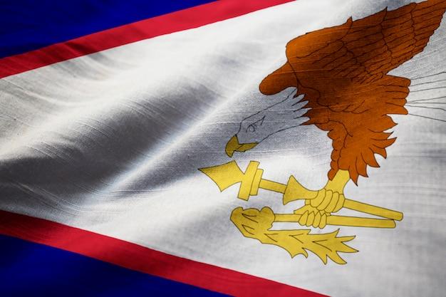 Potargane flaga amerykańskiego samoa wiejący wiatr