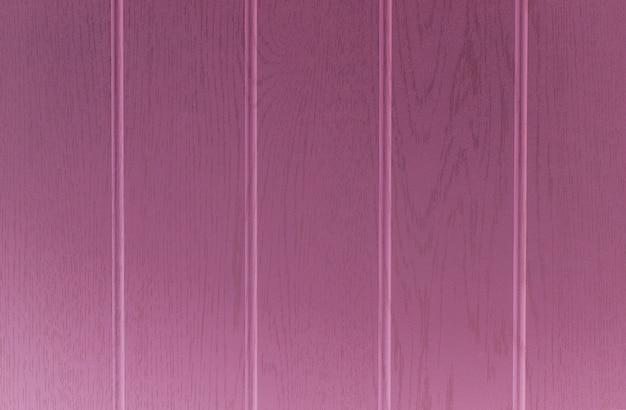 Powierzchnia drewniany tekstury tło z różowym kolorem.
