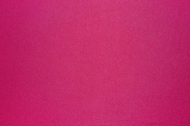 Powierzchnia jasnej tkaniny magenta