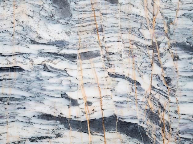 Powierzchnia jasnopopielata marmuru kamienia tekstury tło. ponad milion lat