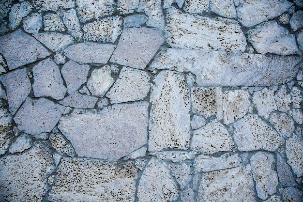 Powierzchnia lub tekstura szarej kamiennej ściany