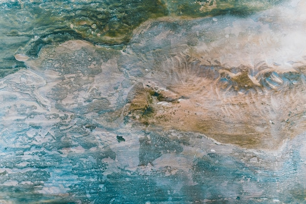Powierzchnia marmuru z odcieniem niebieskim i brązowym. starożytny kamień tekstura tło.