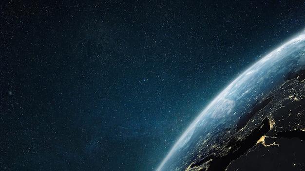 Powierzchnia planety ziemi w przestrzeni kosmicznej. ciemna przestrzeń zewnętrzna tapeta. noc na planecie ze światłami miast. widok z orbity. ziemia w nocy. cywilizacja.