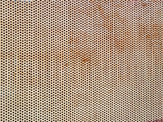 Powierzchnia rdzy na metalowej płytce w kształcie koła