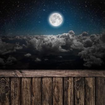 Powierzchnie nocne niebo z gwiazdami i księżycem i chmurami. drewno. elementy tego obrazu dostarczone przez nasa