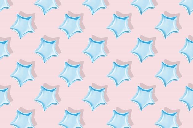 Powietrze balony w kształcie gwiazdy na pastelowym tle