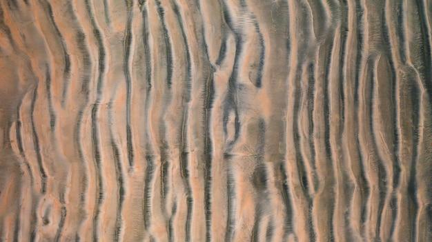 Powietrzny odgórny widok powierzchnia piasek plaży tło