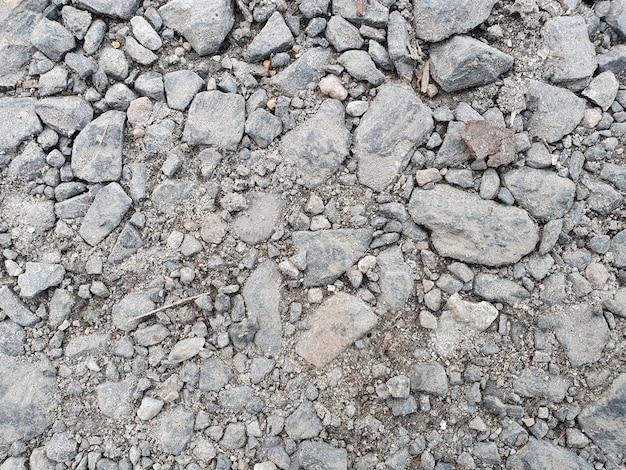Poziome tło asfaltu z kamieniami