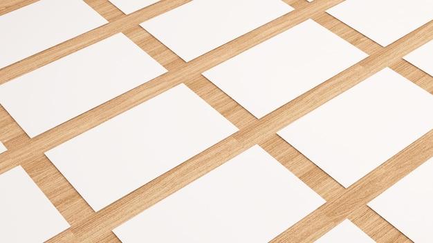 Poziomo ułożone wizytówki na drewnianym tlemakieta wizytówki na białym tle