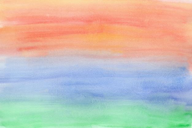 Poziomy gradient natury od zielonego do niebieskiego i pomarańczowego tła akwareli
