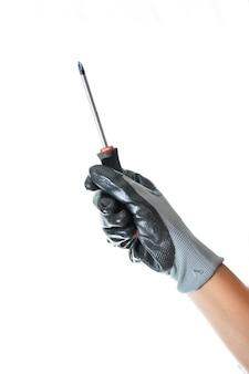 Pracownik posiadający narzędzie do pracy z ręką