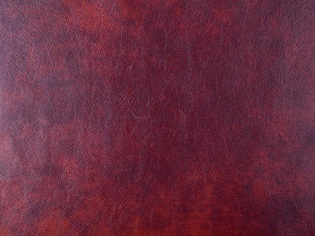 Prawdziwa ciemnoczerwona skóra tekstura tło. zdjęcie makro