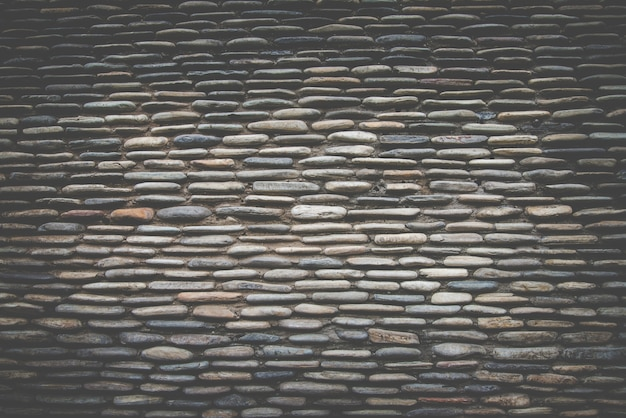 Prawdziwa powierzchnia ściany kamienia, ciemny filtr retro