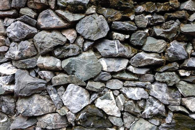 Prawdziwe kamienne ściany tekstury tło ułożone warstw są nierówne