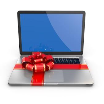 Prezent na laptopa. kokarda i wstążka na klawiaturze
