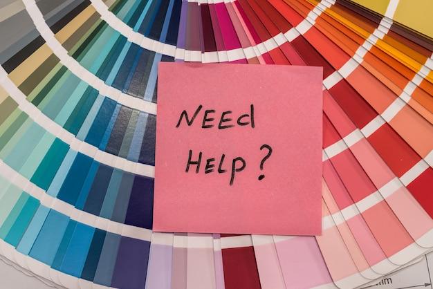 """Próbnik kolorów z dopiskiem """"potrzebujesz pomocy?"""" ścieśniać"""