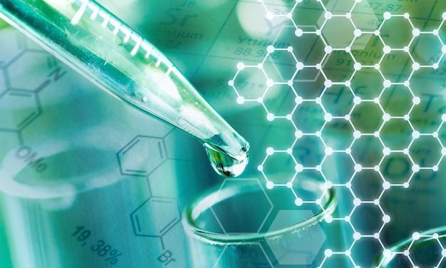 Probówka laboratoryjna i pipeta z kroplą, zbliżenie sprzętu laboratoryjnego