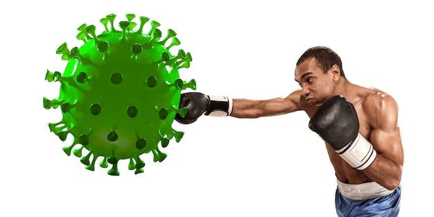 Profesjonalny sportowiec kopiący, uderzający model koronawirusa - walcz z chorobą, bądź silny, bezpieczny. osiągnięcie celu, sport, zdrowy tryb życia, leczenie zapalenia płuc covid-19. zawody, mistrzostwa.