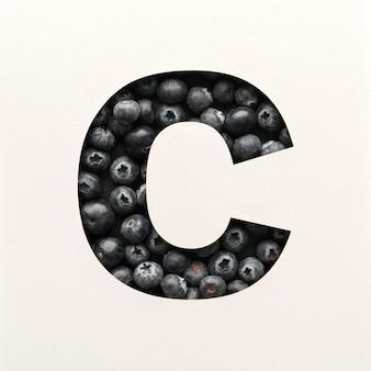 Projekt czcionki, czcionka abstrakcyjna alfabetu z jagodami, realistyczna typografia owoców - c.