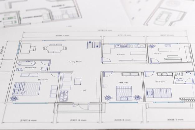 Projekt domu na stole jako zbliżenie tła