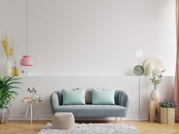 Projekt wnętrza nowoczesnego salonu ciemnoniebieska sofa na pustej białej ścianie, renderowanie 3d