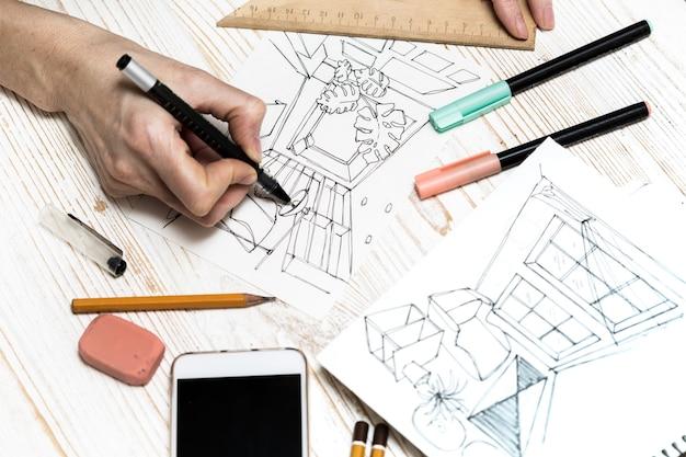 Projektant wykonuje szkic wnętrza markerów do rysowania tła ołówek gumka linijka kalkulator