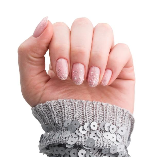 Projektowanie paznokci. boże narodzenie manicure na białym tle