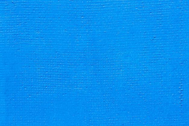 Prosta, pomalowana na niebiesko faktura ściany